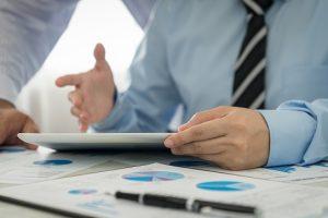 Businessman analyzing financial data of the company.
